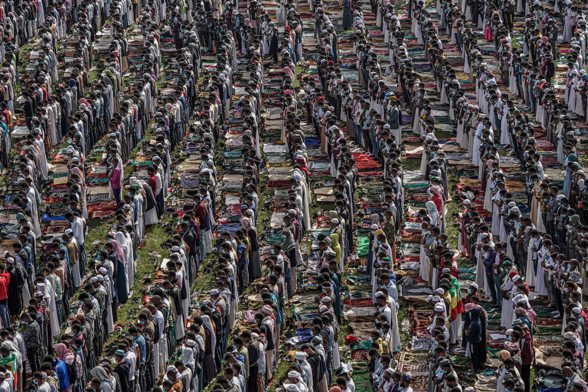 Muslim worshippers pray during the the Eid al-Fitr morning prayer sermon at a soccer stadium in Addis Ababa, Ethiopia, on May 13, 2021 as Muslims across the globe mark the end of the Holy month of Ramadan.