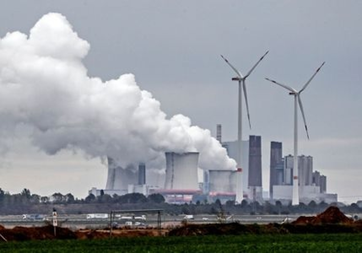 A coal-fired power station steams near the Garzweiler surface coal mine in Germany (File photo)