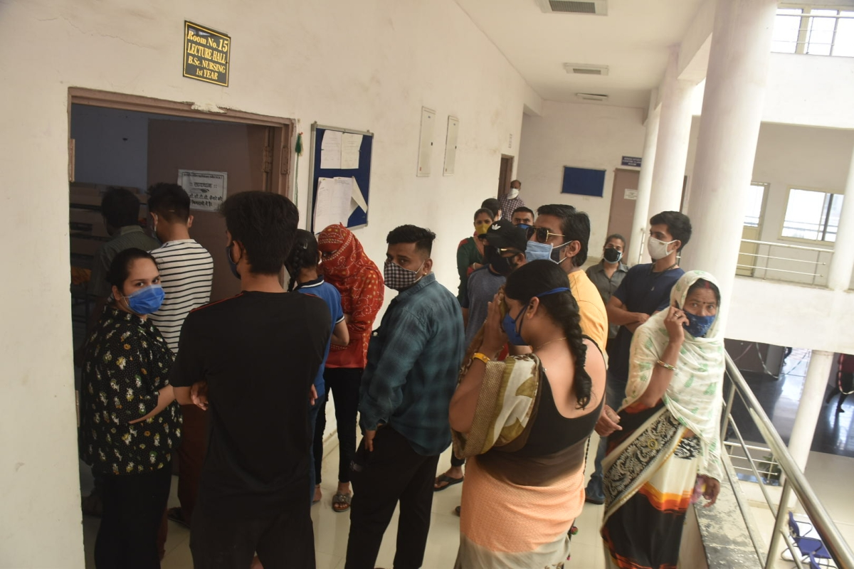 Rush for Jab Job: People thong vaccination centre in Nursing College at Sudama Nagar in Ujjain on Tuesday.