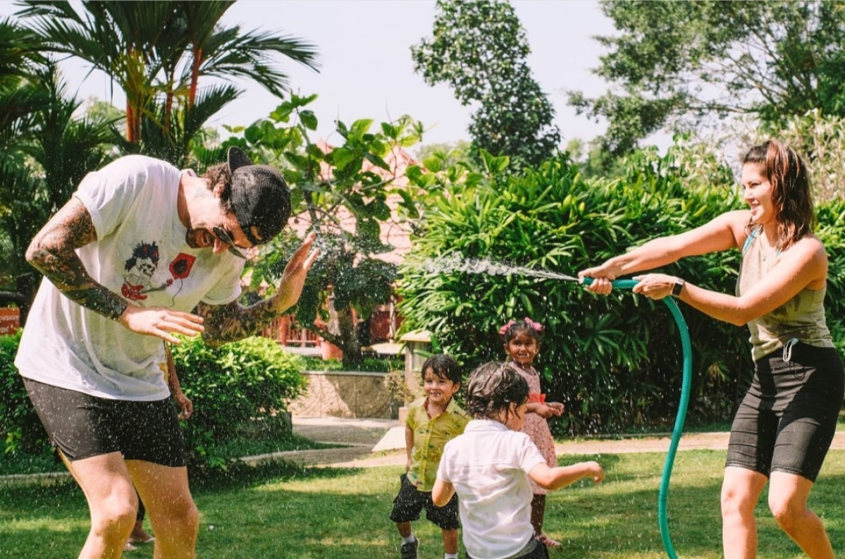 Sunny and her family enjoying a water fight