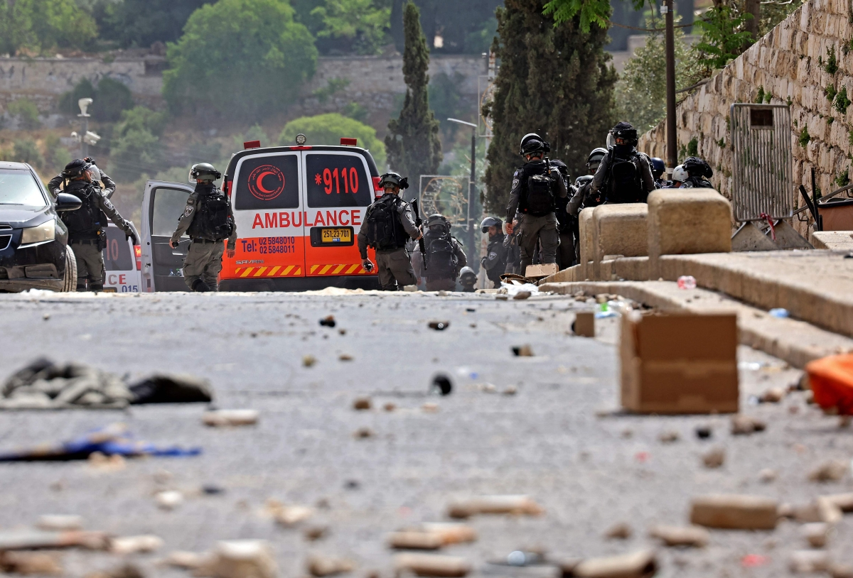 Palestinians clash with Israeli security forces in Jerusalems Old City on May 10, 2021, ahead of a planned march to commemorate Israels takeover of Jerusalem in the 1967 Six-Day War.
