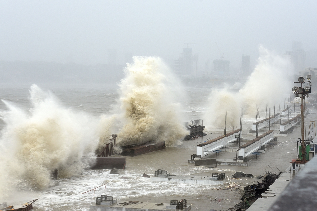 TOPSHOT - Waves lash over onto a shoreline in Mumbai on May 17, 2021, as Cyclone Tauktae, packing ferocious winds and threatening a destructive storm, surge bore down on India, disrupting the countrys response to its devastating Covid-19 outbreak.
