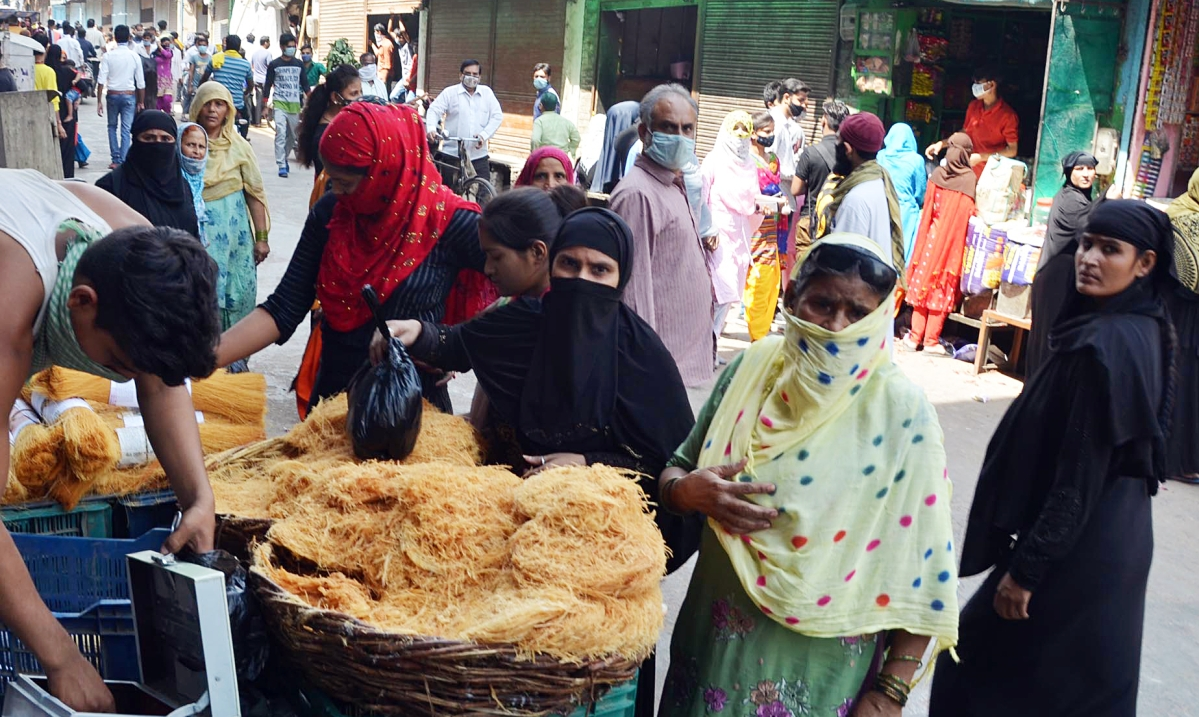 Women purchase Sewaiyan ahead of Eid festival during the lockdown, at a market in Mathura on Tuesday.