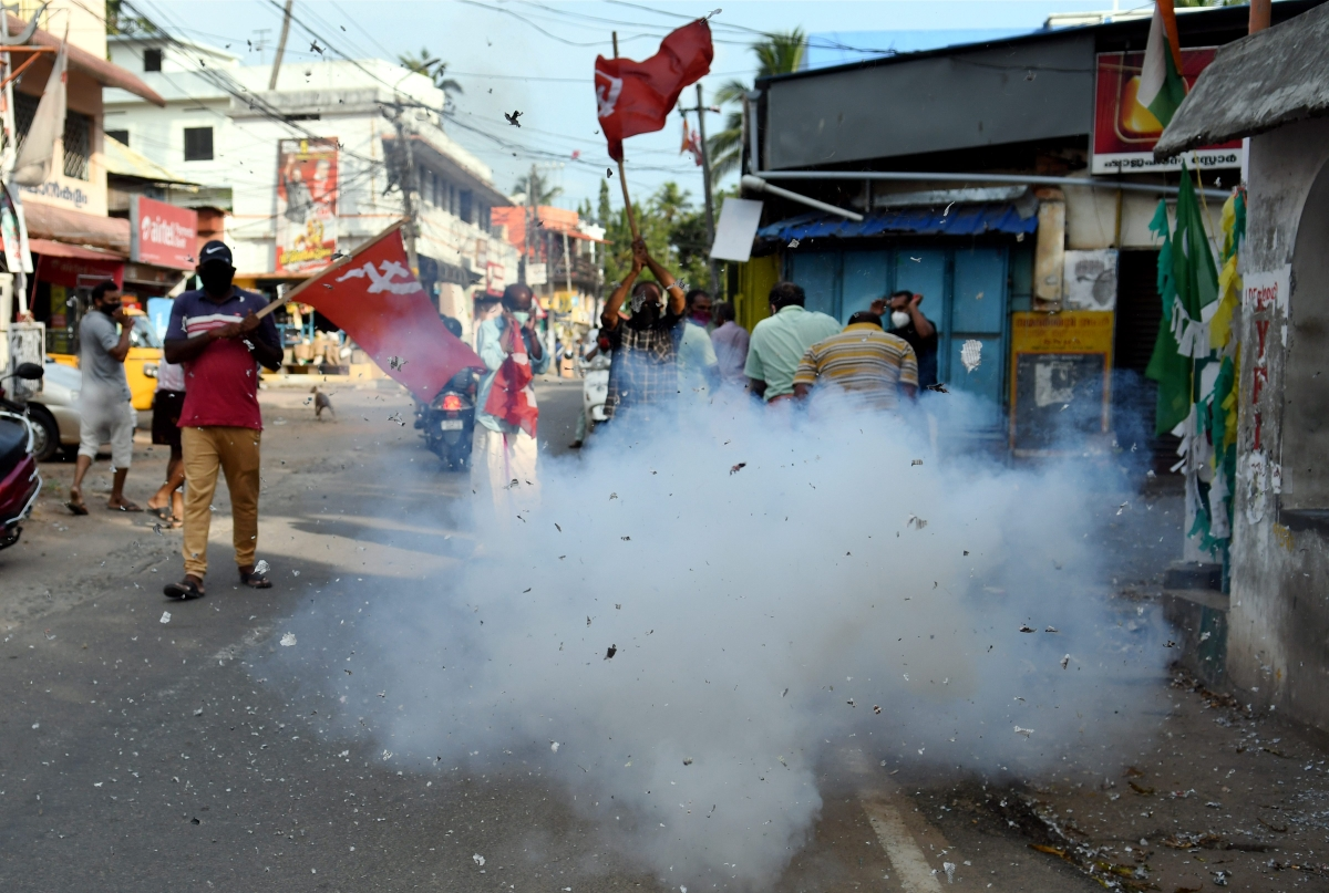 Left Democratic Front (LDF) activists celebrate party's winning trend during counting day of Kerala State Assembly Polls, in Thiruvananthapuram, on May 2, 2021.