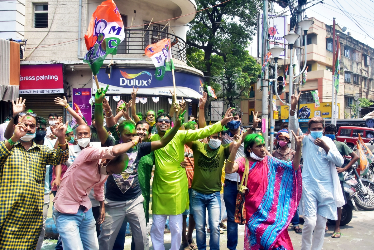 TMC supporters celebrate the party's victory in West Bengal assembly election in front of West Bengal CM Mamata Banerjee's residence, in Kolkata on Sunday.