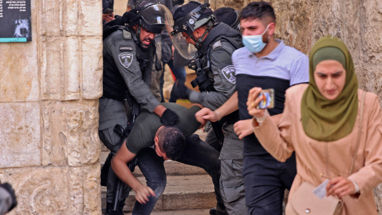 Israeli security forces detain a Palestinian protester amid clashes in Jerusalems Old City on May 10, 2021, ahead of a planned march to commemorate Israels takeover of Jerusalem in the 1967 Six-Day War.