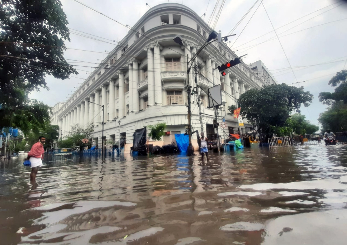 West Bengal, May 27 (ANI): People commute during waterlogged roads after heavy rainfall as an aftermath of cyclone Yaas at CR Avenue in Kolkata on Thursday.