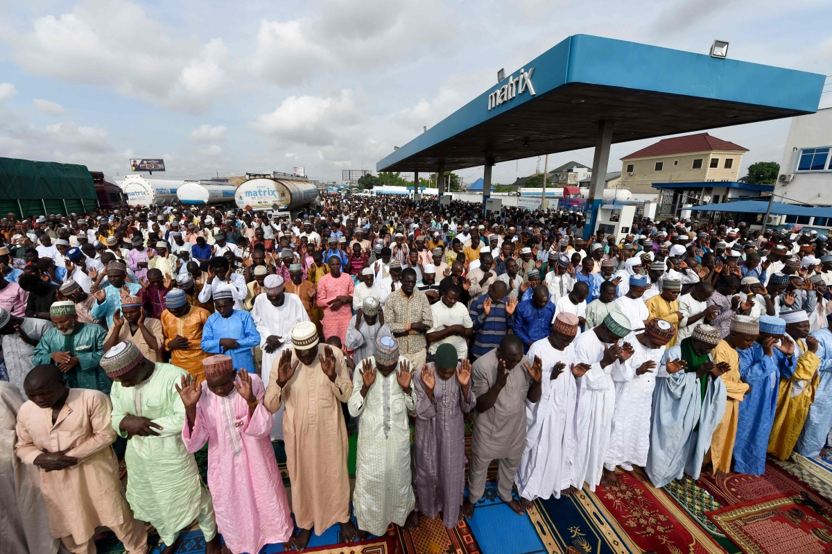 Muslim faithfuls pray at a filling station, Kara Isheri in Ogun State, southwest Nigeria, on May 13, 2021
