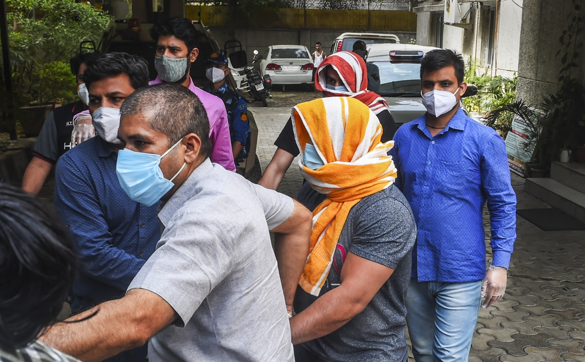 New Delhi: Olympics medal-winning wrestler Sushil Kumar and his associate Ajay Kumar, arrested in connection with the Chhatrasal Stadium brawl that led to the death of a wrestler, being escrted by the police at Saket Police Station, in New Delhi, Sunday, May 23, 2021.