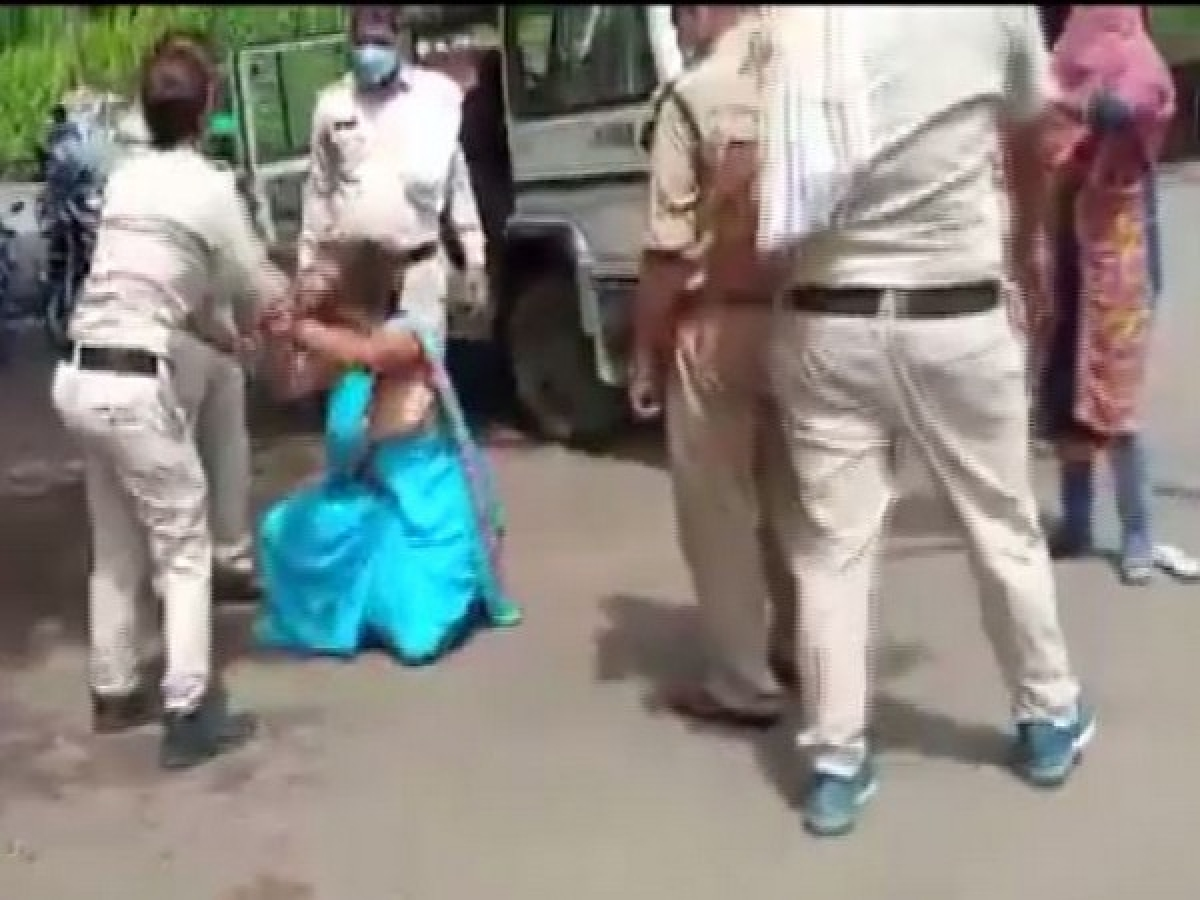 Two police personnel were suspended after a video of showing them thrashing a woman allegedly for not wearing a mask in Sagar district went viral on social media.