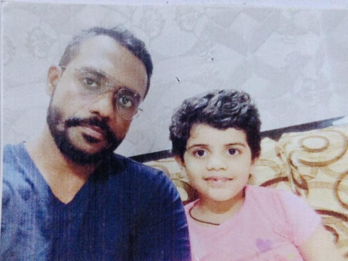 Jitendra Bhadekar, 36, with his daughter Arpita