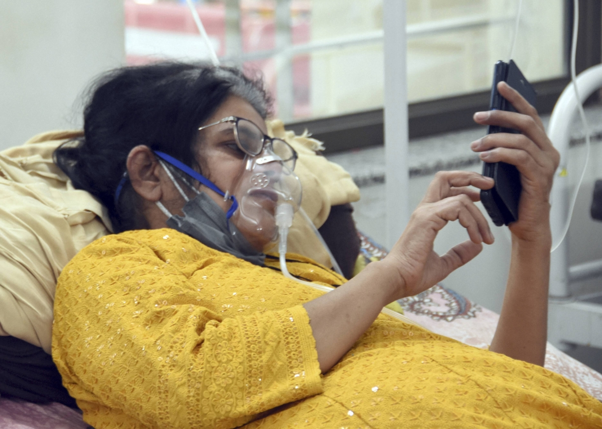 A COVID-19 patient on oxygen support receives treatment at Devji COVID-19 isolation center, during the second wave of coronavirus, in Jabalpur