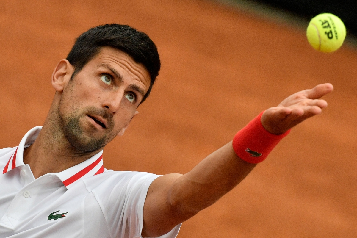 Italian Open: Djokovic loses cool, wins match