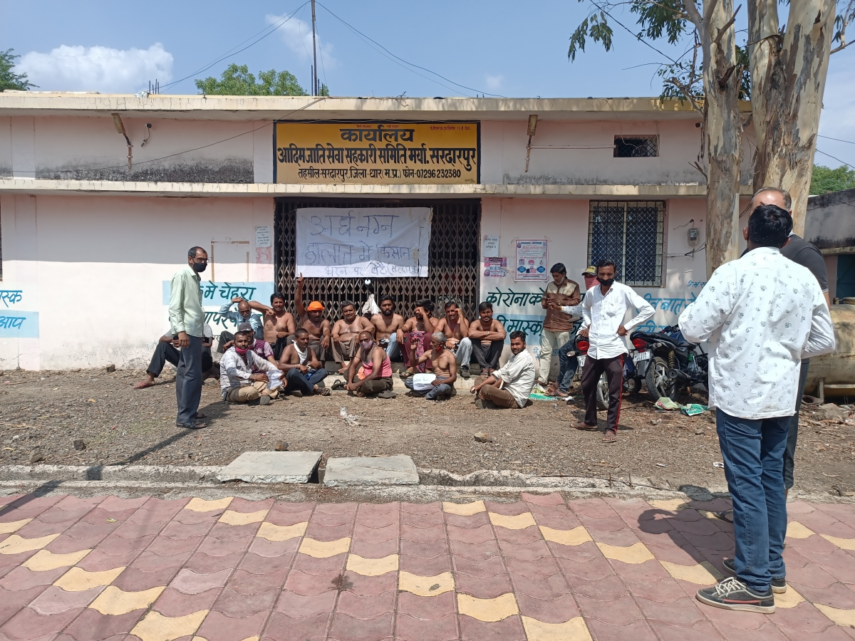 Farmers staged a sit-in in a semi- nude condition outside Tribal Cooperative Society in Sadrapur on Saturday to protest against frequent closure of state government portal