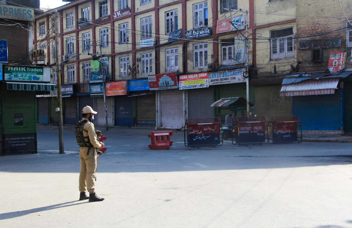 Security man stand guard on a deserted street during corona curfew in Srinagar, Kashmir. As the COVID-19 cases continue to rise the authorities imposed strict Corona curfew across Jammu and Kashmir in order to stop further spread of Coronavirus.