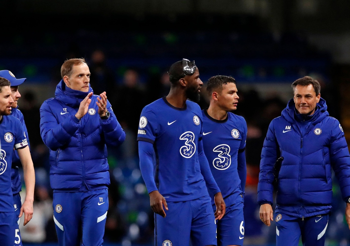 Chelsea's German head coach Thomas Tuchel (L) applauds the fans following after their 2-1 win over Leicester City at the English Premier League football, Stamford Bridge in London on Wednesday.