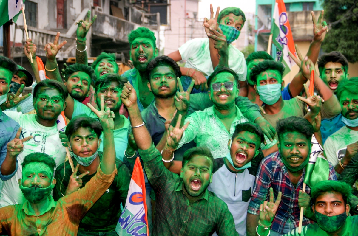 South Dinajpur: Trinamool Congress activists celebrate their partys winning trend during counting day of West Bengal Assembly Election 2021, in South Dinajpur district, Sunday, May 2, 2021.