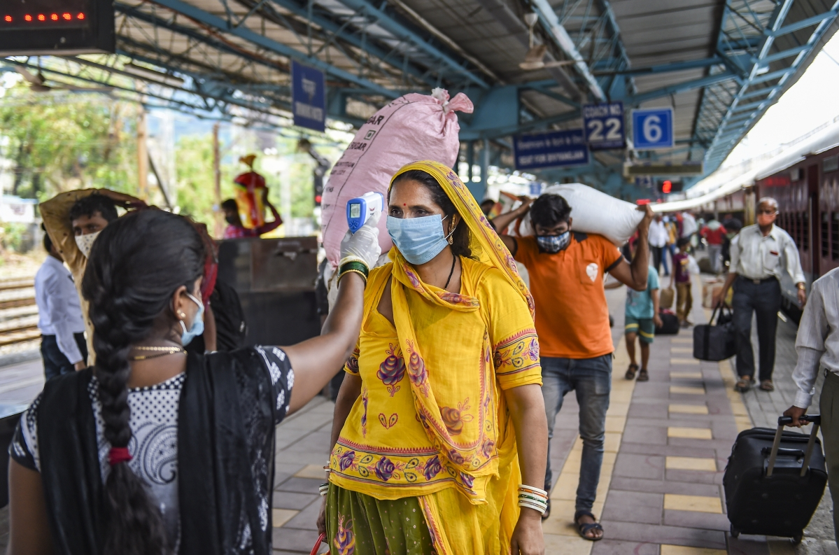 Mumbai: A BMC health worker does the screening of a passenger for COVID-19 test, at a railway station in Mumbai, Thursday, May 27, 2021.