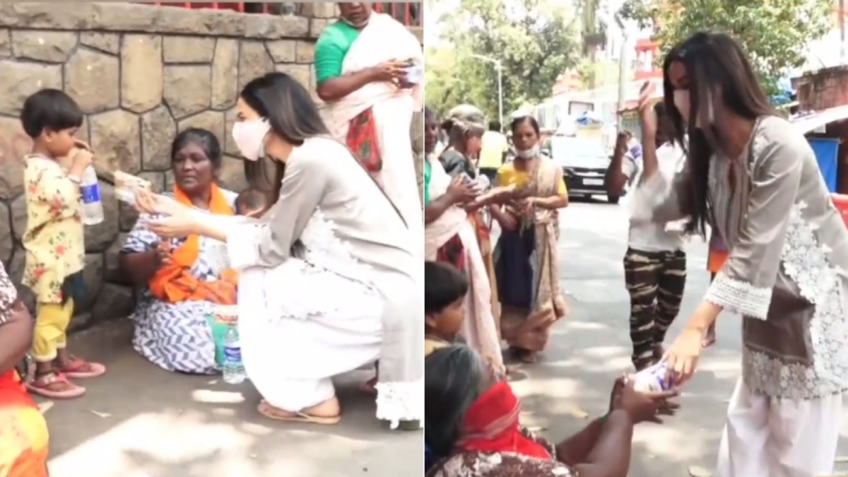 Watch: Sonal Chauhan trolled for distributing biscuits and water to the needy outside Shani temple