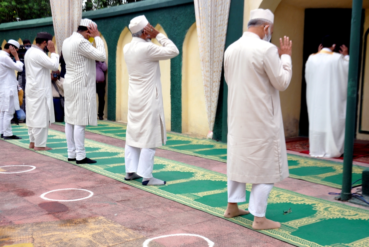 Imam of Aishbagh Eidgah Maulana Khalid Rashid Firangi Mahali along with Muslim devotees perform prayer on the occasion of Eid ul-Fitr festival marking the end of the holy fasting month of Ramadan in Lucknow on Friday.