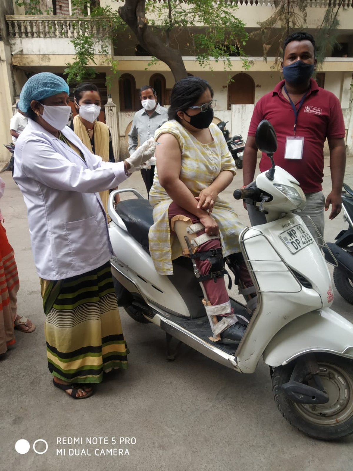 A physically challenged woman being vaccinated at a vaccination centre in Ujjain on Sunday