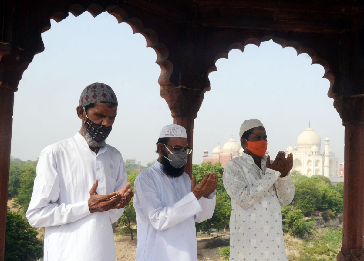 Muslim devotees offer prayers during the Eid-ul-Fitr festival marking the end of the holy fasting month of Ramadan, near Taj Mahal in Agra on Friday.
