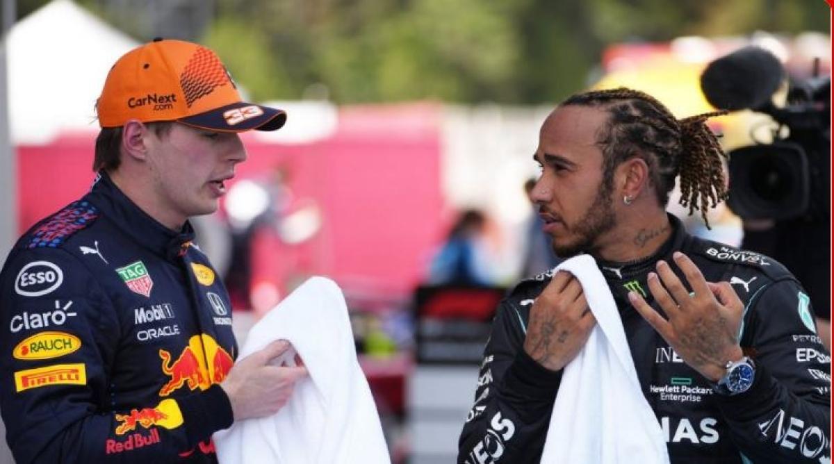 Max Verstappen (L) along with Lewis Hamilton