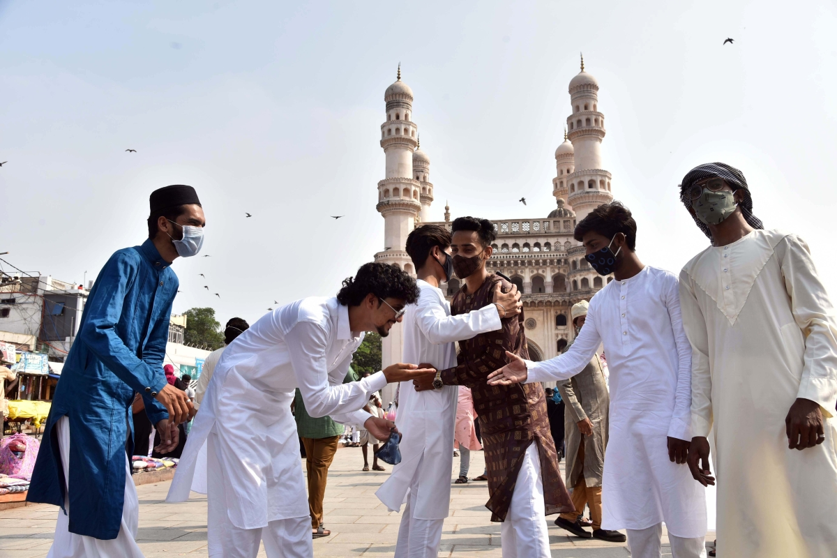 People greet each other on Eid ul-Fitr festival marking the end of the holy fasting month of Ramadan, in Hyderabad on Friday.