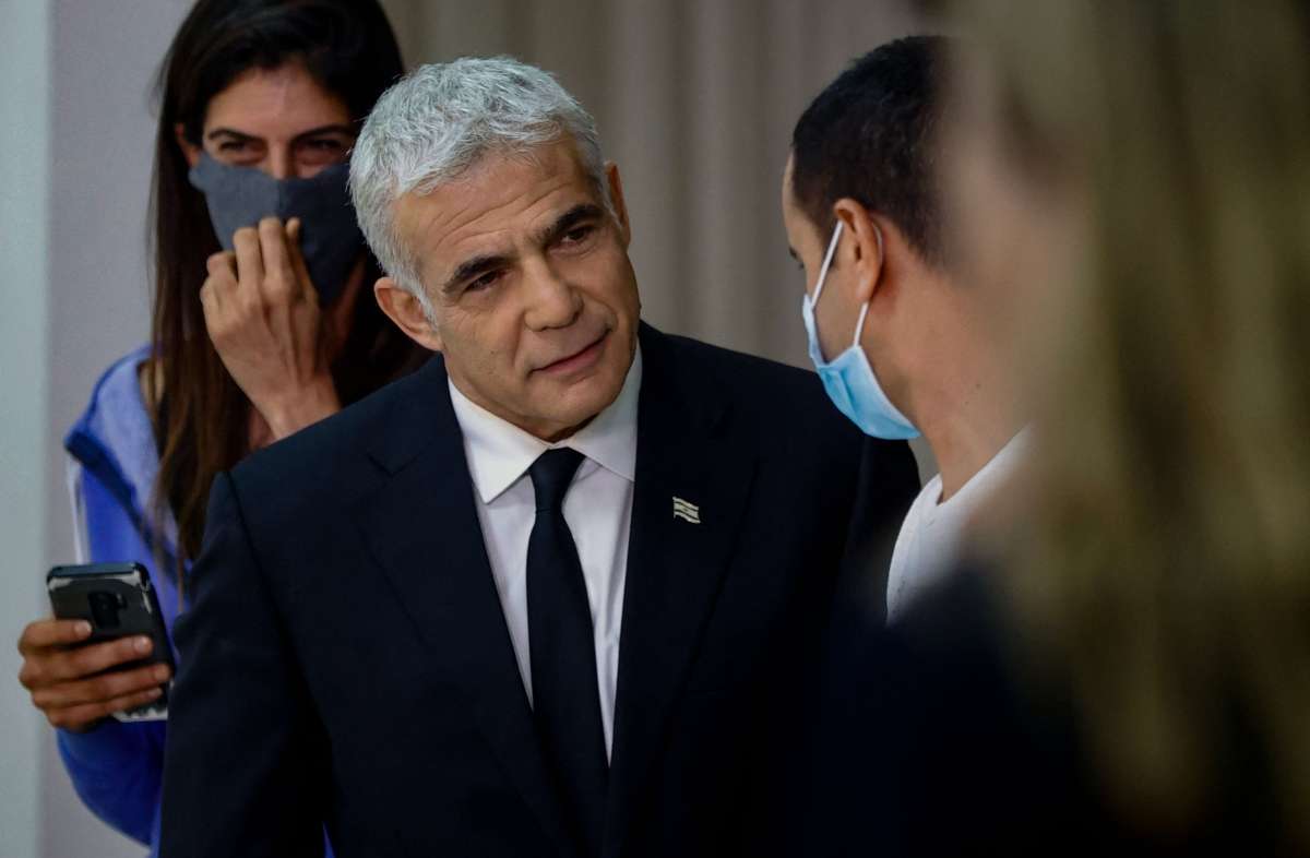 Opposition leader and Chairman of Israels Yesh Atid party Yair Lapid speaks to supporters after giving a press conference in the Israeli coastal city of Tel Aviv, on Thursday.