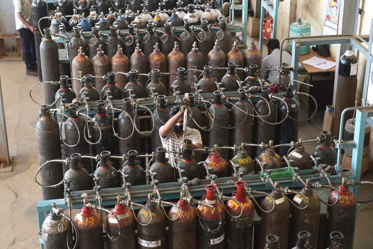 Skilled technicians monitor medical oxygen refilling lines at a supply plant in Ahmedabad on May 3, 2021, as the demand for medical oxygen increased amid Covid-19 coronavirus pandemic.
