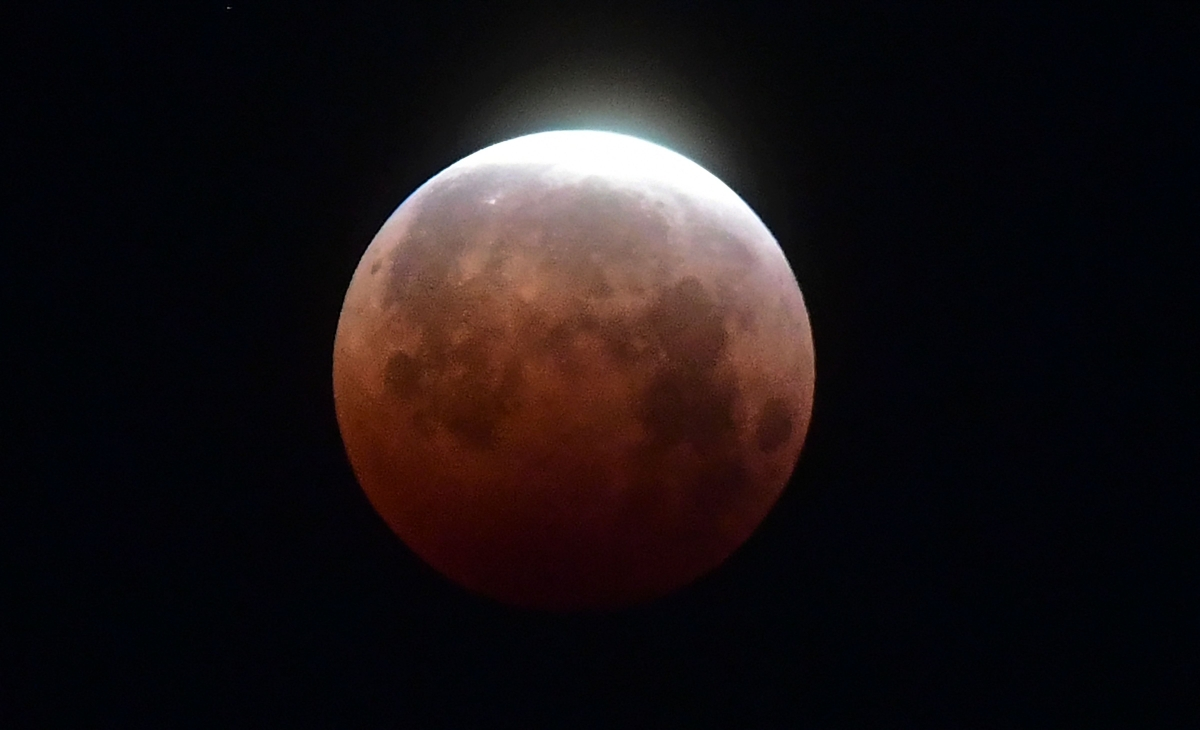 """The Moon as seen over Santa Monica, California on May 26, 2021 during the """"Super Blood Moon"""" total eclipse."""