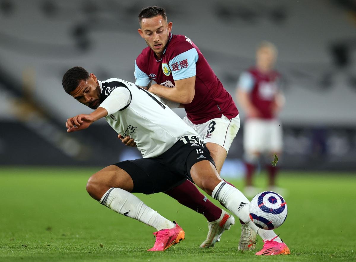 Fulham's English midfielder Ruben Loftus-Cheek (L) is challenged by Burnley's English midfielder Josh Brownhill during the match