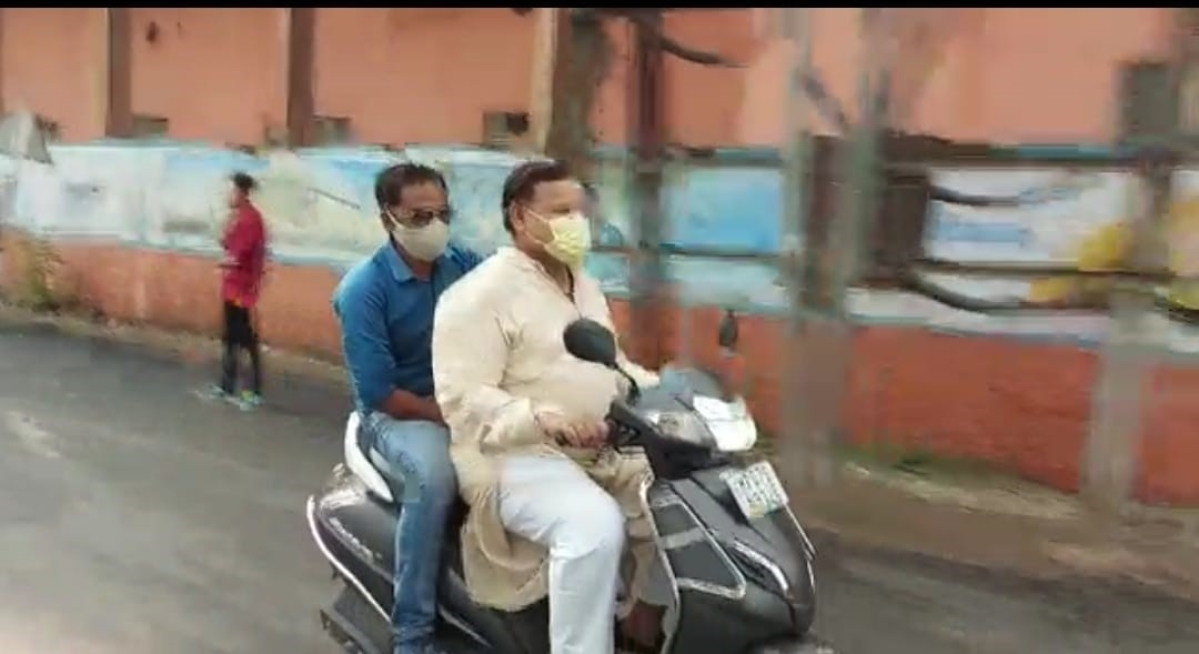 State energy minister Pradhuman Singh Tomar riding a two wheeler without wearing a helmet in Gwalior on Friday.