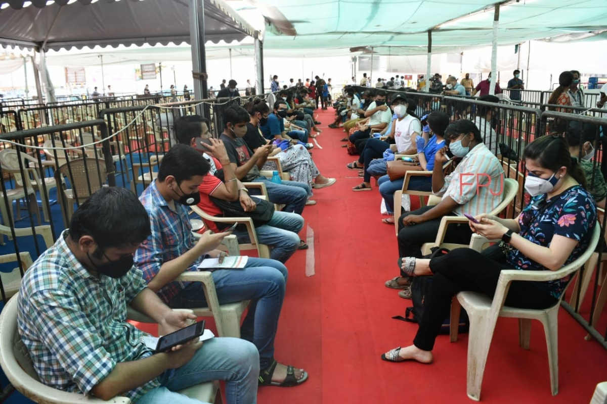People wait for a dose of the Covid-19 coronavirus vaccine at a vaccination centre in Mumbai on May 1, 2021 during the first day of India's vaccination drive to all adults.