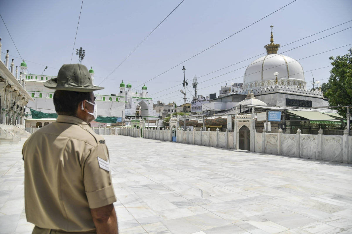 A policeperson stands guard outside a dargah on the occasion of Eid ul-Fitr, marking the end of holy fasting month of Ramadan, during the ongoing COVID-induced lockdown, in Ajmer, Friday, May 14, 2021.