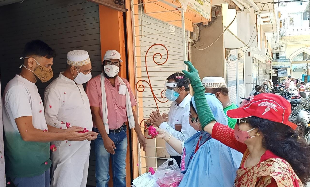 ROSY WELCOME! Residents shower rose petals on corona winners in Ward 14, also known as 'Syedna Ward,' in Ujjain on Friday