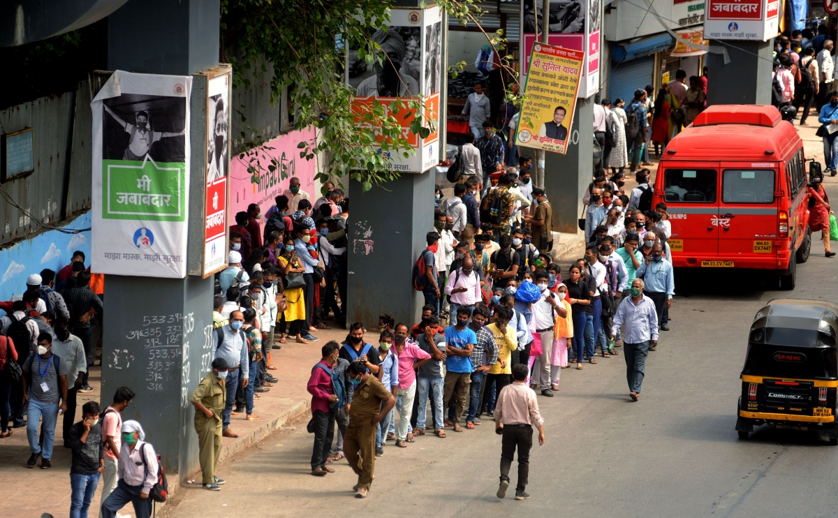 Maharashtra, May 25 (ANI): People at Bus Stop to board a bus for their destination, in Mumbai on Tuesday.