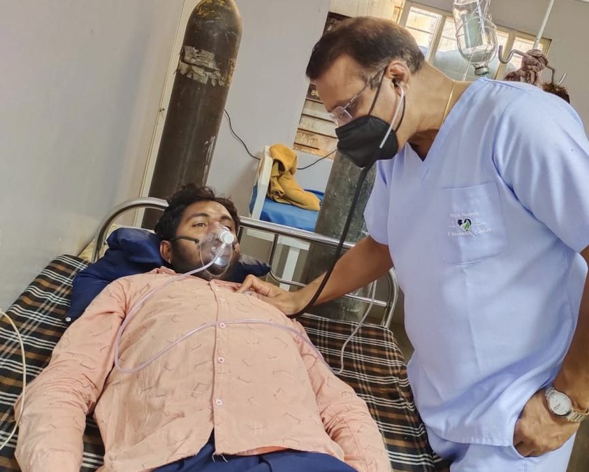 Dr Suresh Ranka examining his patient at hospital in Sanawad town of Khargone district