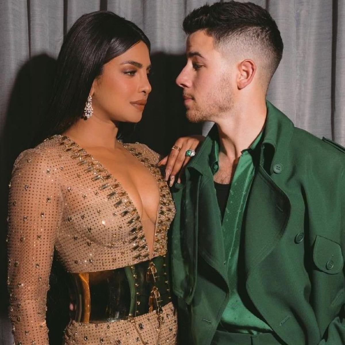 Watch: Nick Jonas fixes wife Priyanka Chopra's gown after locking lips on BBMA red carpet