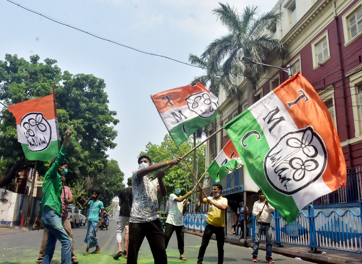 TMC supporters wave the party flag while celebrating the party's victory in West Bengal assembly election in front of West Bengal CM Mamata Banerjee's residence, in Kolkata on Sunday.