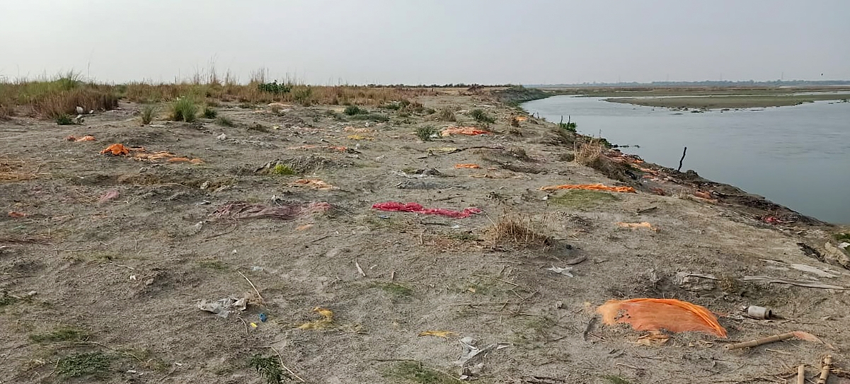 Bodies buried in the sand on the banks of Ganga river, as coronavirus cases surge, in Unnao district