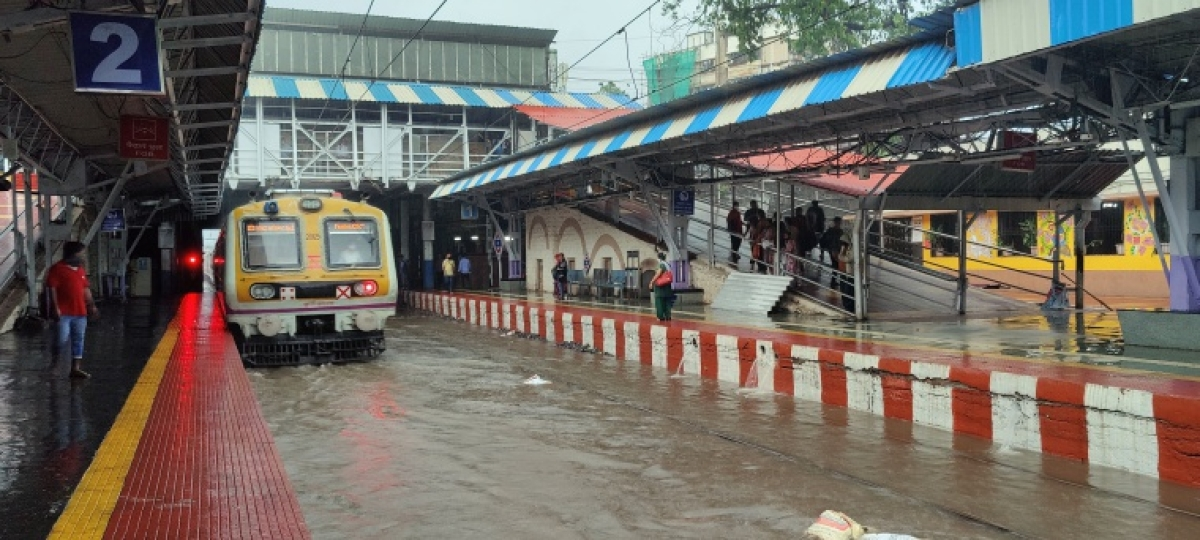 Local train arrives at waterlogged Sion station due to heavy rains