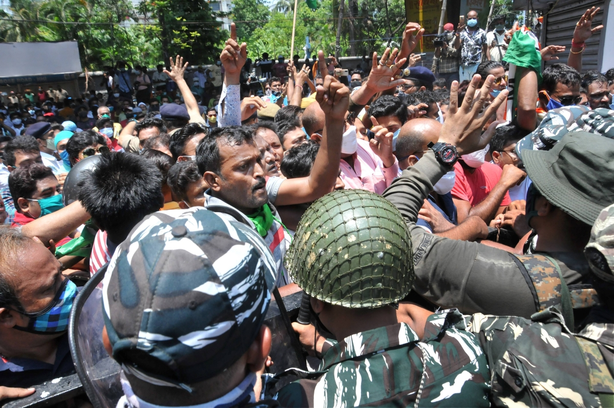 A local leader tries to control TMC workers gathered outside the CBI office Nizam Palace in protest over the arrest of party ministers and MLAs in connection with the Narada scam case, in Kolkata, Monday,