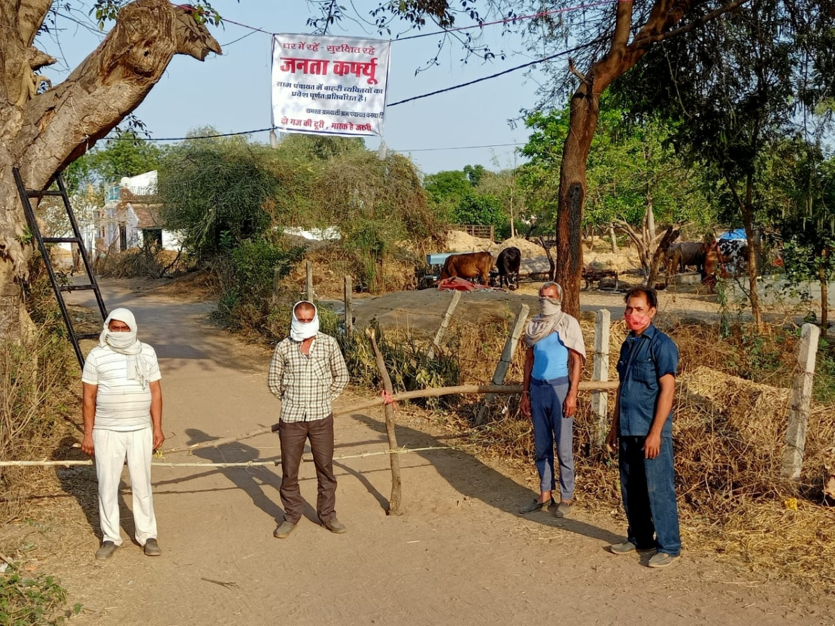Village committee members at a barricade in one of the hamlets in Madhya Pradesh.