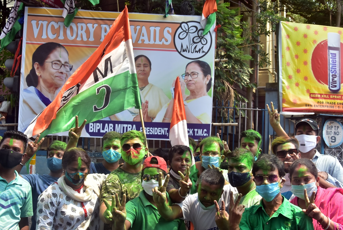 TMC supporters celebrate the partys victory in West Bengal assembly election in front of West Bengal CM Mamata Banerjees residence, in Kolkata on Sunday