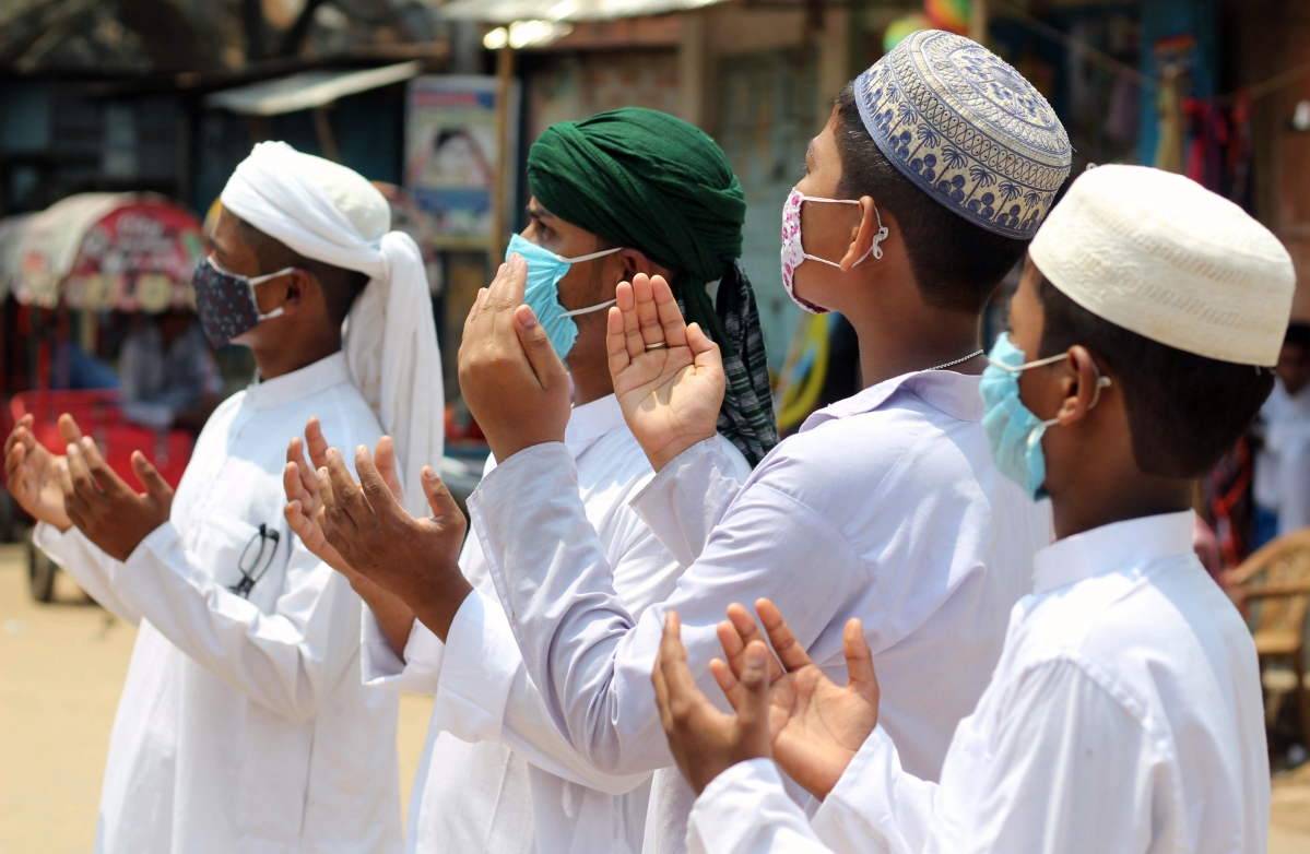 Muslim devotees offer prayers on the occasion of the Eid-ul-Fitr festival, which marks the end of the Islamic holy fasting month of Ramadan, the coronavirus pandemic in Agartala on Friday.