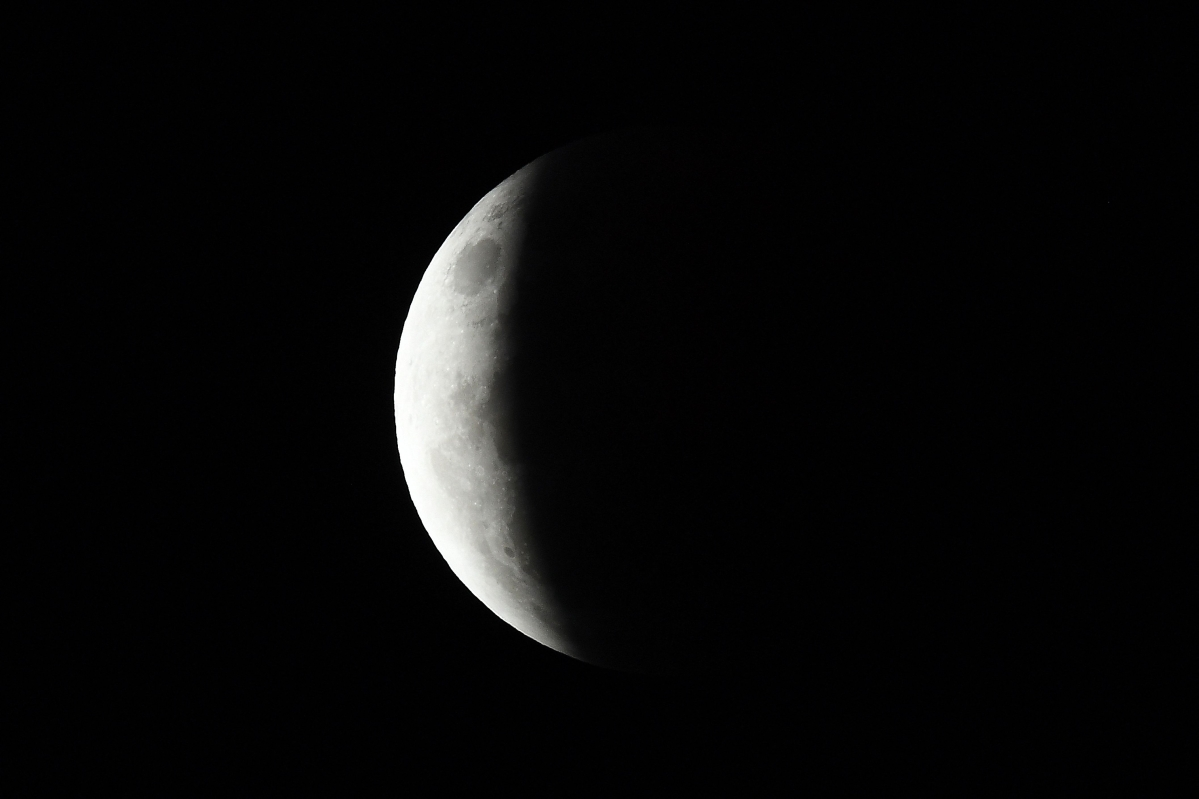 """People set up their cameras and telecopes as they prepare to capture the """"Super Blood Moon"""" in Singapore on May 26, 2021, ahead of a total lunar eclipse as stargazers across the Pacific cast their eyes skyward."""