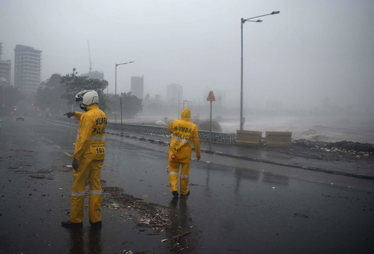 Maharashtra, May 17 (ANI): Mumbai police personnel at Marine Drive during heavy rainfall and strong winds triggered by cyclone Tauktae, in Mumbai on Monday.