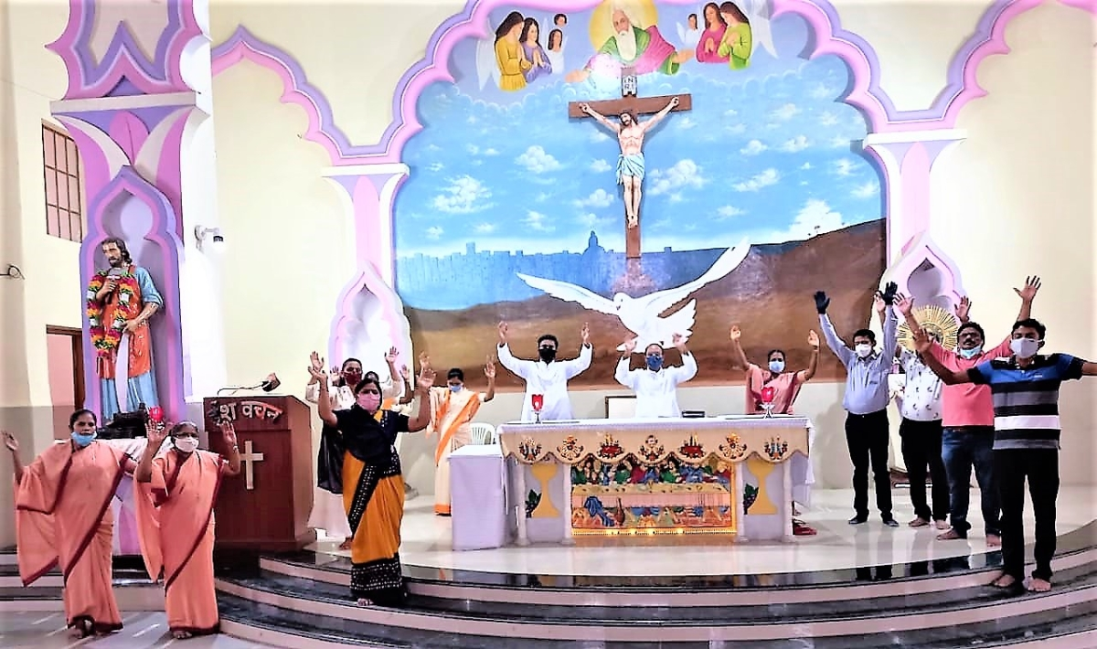 Members of Christian community praying at St Joseph Church in Indore on Sunday