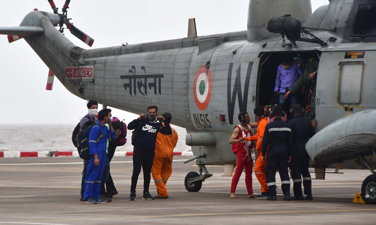 Rescued crew members of barge Gal Construction being brought at INS Shikra in Mumbai on Tuesday